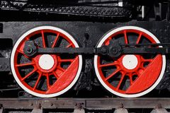 Old black, white and red locomotive is standing on the rails in. A railway museum against a blue sky. The concept of history, the carriage of passengers royalty free stock images