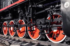 Old black, white and red locomotive is standing on the rails in royalty free stock photos