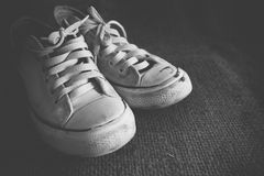 Old black and white sneakers Stock Image