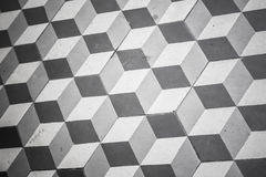 Old black and white tiling on floor, cubic pattern Royalty Free Stock Photos