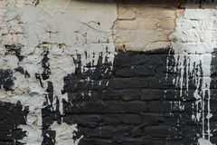 Old black and white wall filled with paint. Textural photo Stock Photos
