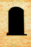 Old black window with red brick wall background Royalty Free Stock Photos