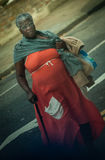 Old black woman crossing street Royalty Free Stock Photography