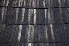 Dark Wood Pattern Background Texture. Roof scale wooden tiles. Old black wooden background. Grunge board. Dark Wood Pattern Background Texture. Roof scale wooden stock images