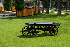 The old black wooden waggon. Stock Photo