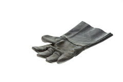 Old black work glove isolated on white Stock Photos