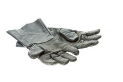 Old black work glove isolated on white Royalty Free Stock Photos
