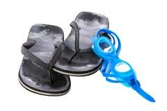 Old black worn boy`s sea slippers. stock photo