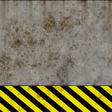 Old Black and Yellow Hazard Stripes Sign Wall Royalty Free Stock Image