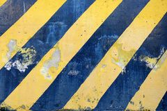 Old Black and Yellow Striped Caution Sign. Old Black and Yellow Striped Caution Sign Background Stock Images