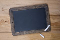 Old blackboard and chalk royalty free stock image