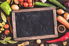 Old blackboard and cooking ingredients Stock Photos