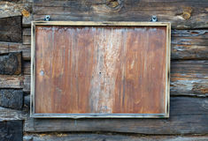Old blackboard on old wooden background Royalty Free Stock Photos