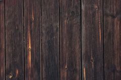 Old black knotty wood texture of bumpy cracked boards. Old blacked knotty wood texture. Wooden background of bumpy cracked boards Royalty Free Stock Photography