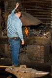 Old blacksmith. At the forge of 19th century blacksmith shop Royalty Free Stock Photo