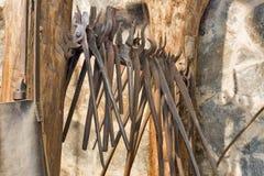 Old blacksmith tongs Royalty Free Stock Image