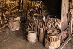 Old blacksmith workshop with tools and furnace Stock Photography
