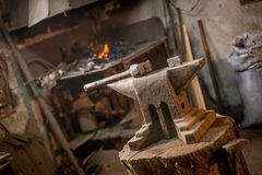 Old blacksmiths hammer on anvil in workshop read to be used for forging iron stock photography
