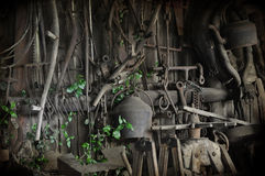 Old Blacksmiths workshop. Detailed view of the interior of an old blacksmiths workshop showing all the tools of the trade Stock Photography