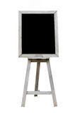 Old Blank black art board, wooden easel, front view. Isolated on white background royalty free stock photo
