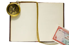 Old blank book with compass and chain. And caribbean dollar stock image