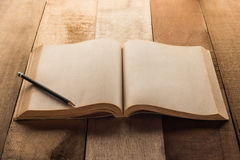 Old blank book open with pancil Royalty Free Stock Photo