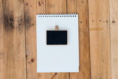 Old blank calendar and black board on wooden Royalty Free Stock Image