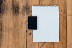 Old blank calendar and black board on wooden Royalty Free Stock Photos