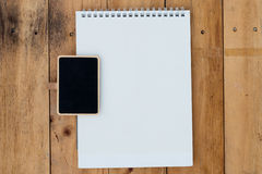 Old blank calendar and black board on wooden Royalty Free Stock Photo
