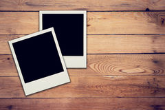 Old blank frame photo on wood background Royalty Free Stock Photos