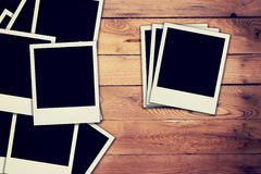 Old blank frame photo on wood background Royalty Free Stock Photography