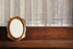 Old blank frame on wooden window sill and urban view Royalty Free Stock Images