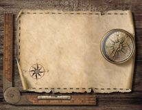 Old blank map background with compass. Adventure and travel concept. 3d illustration. Old blank map background with compass. Adventure or discovery concept royalty free illustration