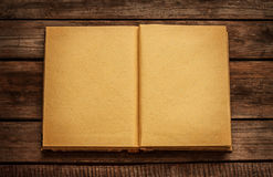 Old blank open book on vintage planked wood table Stock Photo