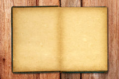 Old blank open notebook on wooden background Royalty Free Stock Images