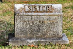 Old blank ornate tombstone sister. Old granite tombstone with engraved sister Royalty Free Stock Photography