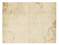 Old Blank Paper with Coffee Ring Stains. Aged and worn paper with creases, coffee ring stains and smudges. Includes clipping path stock photos