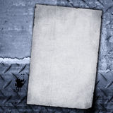 Old blank paper on diamond plate background Stock Photo