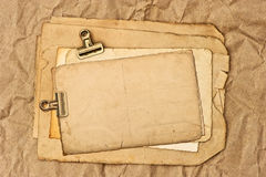 Old blank paper, post card and photo sheets. With clip. grunge background Stock Illustration