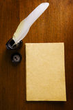 Old blank paper and quill pen Stock Image
