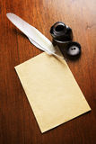 Old blank paper and quill pen Stock Photo
