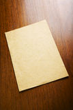 Old blank paper and scroll on wooden table Royalty Free Stock Photography