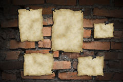 Old blank papers. On a brick wall Royalty Free Stock Photography