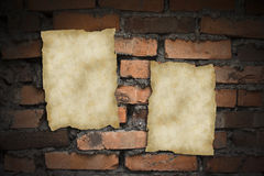 Old blank papers. On a brick wall Royalty Free Stock Image