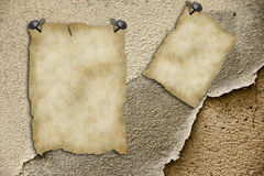 Old blank papers. On a brick wall Stock Photo