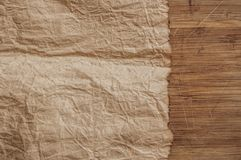 Old paper on the wood background. Old blank parchment on aged wood background royalty free stock images