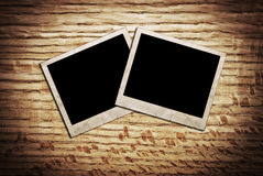 Old blank photos frames lying on a wood surface Royalty Free Stock Photo