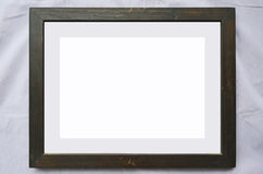 Old blank picture frame for a picture. On frieze clothes Royalty Free Stock Photos