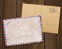 Old blank post card and envelope. Old blank post card and envelope on wooden table vector illustration