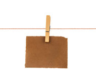 Old blank sheet of paper hanging on a rope Royalty Free Stock Images